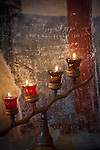 Frescoes with inscriptions carved upon them and lit with candles inside the Church of the Ascension of Jesus Christ at the Monastery Mileševa, Serbia originally built in the 13th century.
