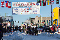 Jessie Royer and team leave the ceremonial start line with an Iditarider and handler at 4th Avenue and D street in downtown Anchorage, Alaska on Saturday March 4th during the 2017 Iditarod race. Photo © 2017 by Brendan Smith/SchultzPhoto.com.