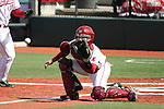 Jay Ponciano, Washington State catcher, positions himself to catch the ball and block the plate during a run-down in the Cougars Pac-10 conference victory over the Oregon State Beavers at Bailey-Brayton Field in Pullman, Washington, on April 24, 2010.