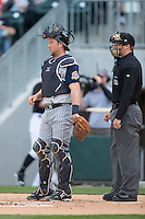 Toledo Mud Hens catcher Bryan Holaday (16) and home plate umpire Matt McCoy during the game against the Charlotte Knights at BB&T BallPark on April 27, 2015 in Charlotte, North Carolina.  The Knights defeated the Mud Hens 7-6 in 10 innings.   (Brian Westerholt/Four Seam Images)