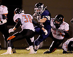 HARTFORD, SD - NOVEMBER 6: Joseph Hanisch #41 from West Central tries to slip between Nick Kayl #30 and Jaetin DeCou #32 from Lennox in the first half of their 11A semifinal game Friday night in Hartford.  (Photo by Dave Eggen/Inertia)