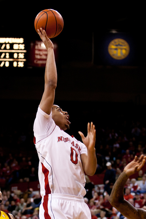 20 December 2011: Toney McCray #0 of the Nebraska Cornhuskers puts up a jump shot against the Central Michigan Chippewas during the first half at the Devaney Sports Center in Lincoln, Nebraska. Nebraska defeated Central Michigan 72 to 69.