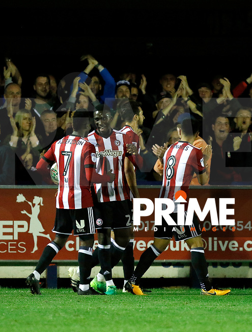 GOAL - Brentford's Justin Shaibu celebrates his goal during the Carabao Cup match between AFC Wimbledon and Brentford at the Cherry Red Records Stadium, Kingston, England on 8 August 2017. Photo by Carlton Myrie.