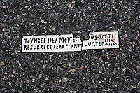 A Toynbee Tile is embedded in the asphalt of a crosswalk at 19th Street on the north side of Logan Square on Benjamin Franklin Parkway in Philadelphia, Pennsylvania, USA. The Toynbee Tiles are of unknown origin and have appeared in dozens of cities around North and South America, with many in Philadelphia.