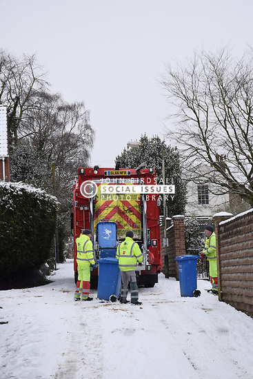 Refuse collectors struggling with the snow, Norwich Feb 2018 UK