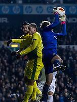 12.12.2013 London, England. Anzhi Makhachkala goalkeeper Evgeniy Pomazan (1) claims a corner during the Europa League game between Tottenham Hotspur and Anzhi Makhachkala from White Hart Lane.