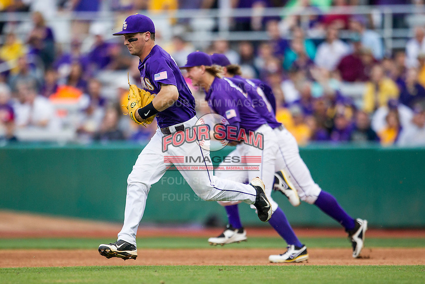 LSU Tigers shortstop Alex Bregman (8) runs out to his position before the Southeastern Conference baseball game against the Texas A&M Aggies on April 24, 2015 at Alex Box Stadium in Baton Rouge, Louisiana. LSU defeated Texas A&M 9-6. (Andrew Woolley/Four Seam Images)