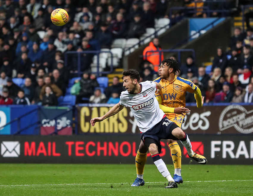 Bolton Wanderers' Will Buckley competing with Wigan Athletic's Reece James<br /> <br /> Photographer Andrew Kearns/CameraSport<br /> <br /> The EFL Sky Bet Championship - Bolton Wanderers v Wigan Athletic - Saturday 1st December 2018 - University of Bolton Stadium - Bolton<br /> <br /> World Copyright © 2018 CameraSport. All rights reserved. 43 Linden Ave. Countesthorpe. Leicester. England. LE8 5PG - Tel: +44 (0) 116 277 4147 - admin@camerasport.com - www.camerasport.com