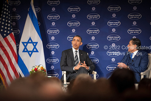 United States President Barack Obama participates in a conversation with Saban Forum Chairman Haim Saban at the 10th annual Saban Forum, &quot;Power Shifts: U.S.-Israel Relations in a Dynamic Middle East&quot; at the Willard Hotel on December 7, 2013 in Washington, DC. Obama defended the nuclear agreement with Iran and took questions from the audience.<br /> Credit: Pete Marovich / Pool via CNP