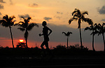KONA-KAILUA, HI - OCTOBER 11: A silhouette of a competitor during the 26.2-mile Honolulu Marathon at the 2014 IRONMAN Triathlon World Championships presented by GoPro on October 11, 2014 in Kailua-Kona, Hawaii. (Photo by Donald Miralle) *** Local Caption ***