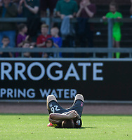 Lincoln City's Harry Anderson lays on the pitch at the end of the game<br /> <br /> Photographer Chris Vaughan/CameraSport<br /> <br /> The EFL Sky Bet League Two - Carlisle United v Lincoln City - Friday 19th April 2019 - Brunton Park - Carlisle<br /> <br /> World Copyright © 2019 CameraSport. All rights reserved. 43 Linden Ave. Countesthorpe. Leicester. England. LE8 5PG - Tel: +44 (0) 116 277 4147 - admin@camerasport.com - www.camerasport.com
