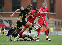 Ryan Dickson of Brentford challenges Andros Townsend of Leyton Orient