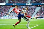 Angel Correa (L) of Atletico de Madrid competes for the ball with Adrian Embarba Blazquez, A Embarba, of Rayo Vallecano during the La Liga 2018-19 match between Atletico de Madrid and Rayo Vallecano at Wanda Metropolitano on August 25 2018 in Madrid, Spain. Photo by Diego Souto / Power Sport Images