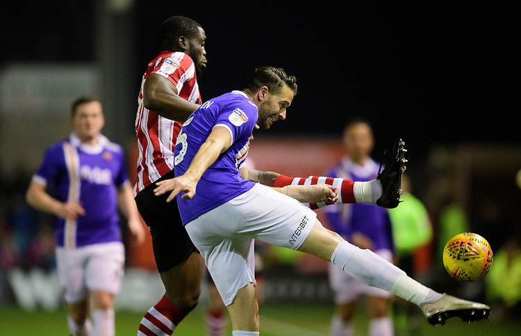 Exeter City's Aaron Martin under pressure from Lincoln City's John Akinde<br /> <br /> Photographer Chris Vaughan/CameraSport<br /> <br /> The EFL Sky Bet League Two - Lincoln City v Exeter City - Tuesday 26th February 2019 - Sincil Bank - Lincoln<br /> <br /> World Copyright © 2019 CameraSport. All rights reserved. 43 Linden Ave. Countesthorpe. Leicester. England. LE8 5PG - Tel: +44 (0) 116 277 4147 - admin@camerasport.com - www.camerasport.com