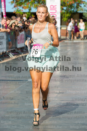 Participant attends the yearly Stiletto Run organized by Glamour magazine in Budapest, Hungary on September 08, 2012. ATTILA VOLGYI