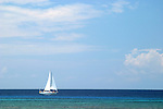 This sailboat was plying the deeper waters off West Bay on the Island of Roatan in the Honduran Bay Islands.
