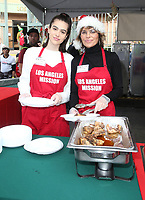 21 December 2018 - Los Angeles, California - Delilah Hamlin and Lisa Rinna. Los Angeles Mission Christmas Meal for the Homeless held at Los Angeles Mission. Photo Credit: F. Sadou/AdMedia
