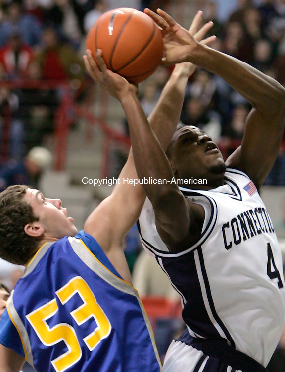 STORRS, CT--23 December 2005- 122305JS05-<br /> UConn's Jeff Adrien gets fouled by Morehead State's Clinton Reisz as he goes up for a shot during their game Friday at Gampel Pavilion in Storrs. <br />  --Jim Shannon Republican American-- UConn; Morehead State; Gampel Pavilion; Storrs; Jeff Adrien, Clinton Reisz  are CQ