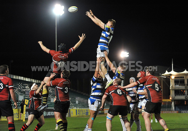 Freddie Clarke rises high to win lineout ball. End-of-season friendly match, between Bath United and Somerset County Senior XV on April 14, 2014 at the Recreation Ground in Bath, England. Photo by: Patrick Khachfe / Onside Images