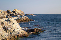 White cliffs on the St Pierre des Embies island outside Sanary with dark blue sea and sky at late afternoon sunshine Le Brusc Six Fours Var Cote d'Azur France
