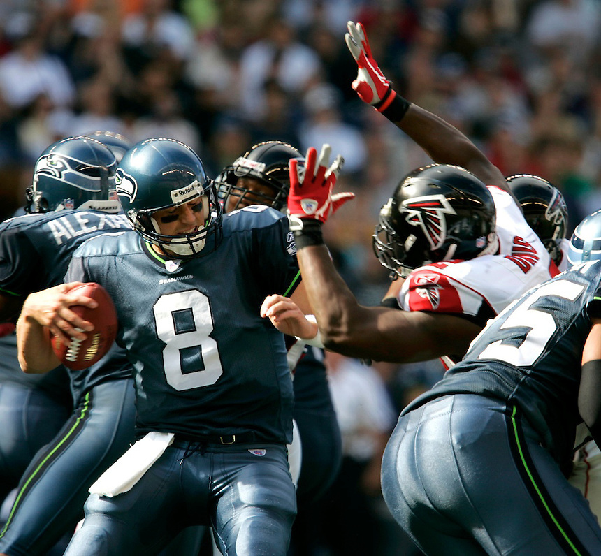 Seattle's QB Matt Hasselbeck (#8), is pressured by Atlanta's Chauncy Davis Webster, right, during the Seahawks home opener against Atlanta Falcons at Qwest Field in Seattle, Washington on Sunday Sept. 18, 2005(Kevin P. Casey/Wireimage.com)