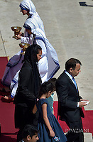 Brazilian mechanical engineer Marcilio Andrino (C) and his wife Fernanda Nascimento Rocha leave after greeting Pope Francis during a Holy Mass and canonisation for Mother Teresa of Kolkata, on Saint Peter's Square in the Vatican, on September 4, 2016.