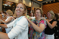 """Janice Wikgren (JANICE WIKGREN), left, savors a backrub from fellow Southern Arizona Women's Chorus member Mary Pat DiCurti (MARY PAT DICURTI) during a rehearsal at the Grand Hyatt in New York, NY on Friday, June 23, 2006.  The Chorus performed Brusa's """"Missa pro defunctis"""" and Beach's """"The Rose of Avontown, Op. 30"""" at Carnegie Hall on Sunday night."""