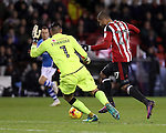 Leon Clarke of Sheffield United takes on Neil Etheridge of Walsall outside the box during the English Football League One match at Bramall Lane, Sheffield. Picture date: November 29th, 2016. Pic Jamie Tyerman/Sportimage
