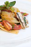 Detail of a plate of fettuccine with anchovies and  pomodorino piennolo del Vesuvio tomatoes at the restaurant La Torre del Saraceno, Vico Equense in Italy