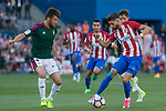 Oier Sanjurjo of Club Atletico Osasuna competes for the ball with Yannick Ferreira Carrasco of Atletico de Madrid during the match of La Liga between  Atletico de Madrid and Club Atletico Osasuna at Vicente Calderon  Stadium  in Madrid, Spain. April 15, 2017. (ALTERPHOTOS / Rodrigo Jimenez)
