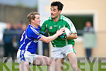 Laune Rangers Mike Francis Russell holds up St Brendan's John Dowling during their County Championship game in Killorglin Saturday evening