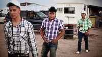 Mexican spectators at a local race meeting in Dodge CIty, Kansas. Horse racing is a favourite past time of many of the Hispanic migrant workers who have come to the area to work in its meat packing plants. .