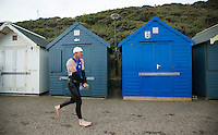 27 JUL 2013 - CROMER, GBR - Timothy Chapman runs along the promenade at Cromer, North Norfolk, Great Britain on his way to transition after completing The Anglian Triathlon 2013 swim (PHOTO COPYRIGHT © 2013 NIGEL FARROW, ALL RIGHTS RESERVED)