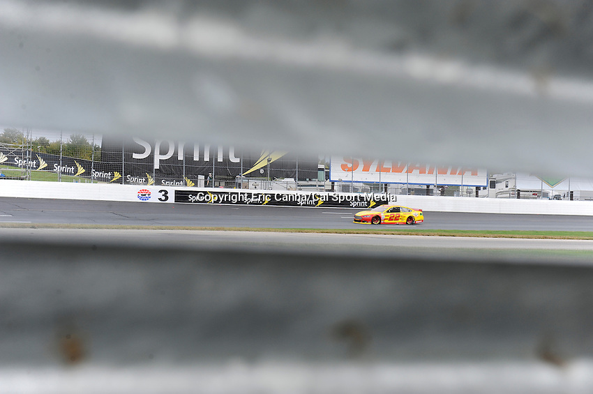 September 21, 2014 - Loudon, New Hampshire, U.S. - Sprint Cup Series driver Joey Logano (22) races into turn 3 at  the Nascar Sprint Cup Series Sylvania 300 race held at the New Hampshire Motor Speedway in Loudon, New Hampshire.   Eric Canha/CSM