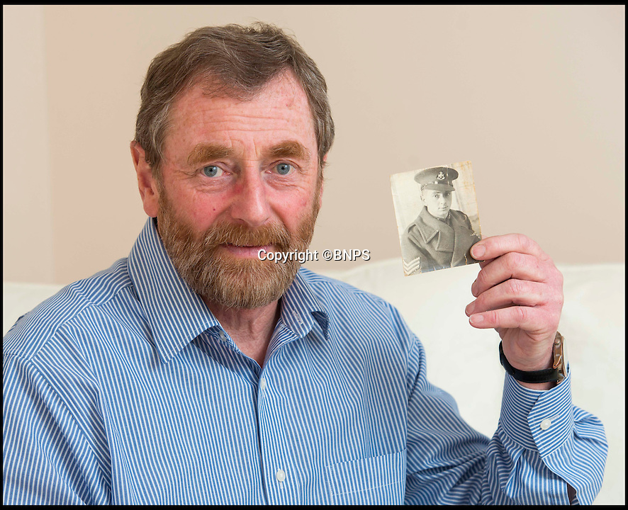 BNPS.co.uk (01202 558833)<br /> Pic: TomWren/BNPS<br /> <br /> Steve Foster with a picture of his father Frederick.<br /> <br /> The poignant story of how a British Prisoner of War paid with his life for turning back for a comrade during an audacious escape has been uncovered in an old suitcase.<br /> <br /> Frederick Foster and Antony Coulthard had travelled 1,000 miles across Poland and Germany before one of them was caught by a German guard on the Swiss border.<br /> <br /> Coulthard, who was free, went back for him and was also caught. He went on to die on a 'death march' towards the end of the war. <br /> <br /> Now Sgt Foster's son Steve is turning the epic escape into a book.
