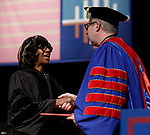 Paulette Brown, honorary degree recipient and commencement speaker, left, is congratulated by the Rev. Dennis H. Holtschneider, C.M., president of DePaul during the DePaul University College of Law commencement ceremony, Sunday, May 14, 2017. The ceremony was held at the Rosemont Theatre in Rosemont, IL, where some 240 students received their Juris Doctors or Master of Laws degrees. (DePaul University/Jeff Carrion)