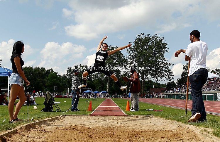 New Britain, CT- 03 June 2013-060313CM07- Mike Lang of Woodland High School sails through the air during the long jump at the State Open Track and Field meet at Willow Brook Park in New Britain Monday afternoon.    Christopher Massa Republican-American