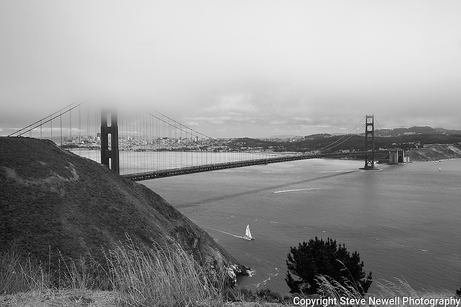 """Fun in the Bay"" Black and White Golden Gate Bridge and San Francisco.  Although the strait may be difficult to sail or go boating it doesn't stop people from enjoying the Bridge with San Francisco in the background. Day or night, sunrise or sunset this is some of the most beautiful scenery in all of California if not the world."