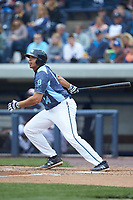 Reynaldo Rivera (14) of the West Michigan Whitecaps follows through on his swing against the South Bend Cubs at Fifth Third Ballpark on June 10, 2018 in Comstock Park, Michigan. The Cubs defeated the Whitecaps 5-4.  (Brian Westerholt/Four Seam Images)