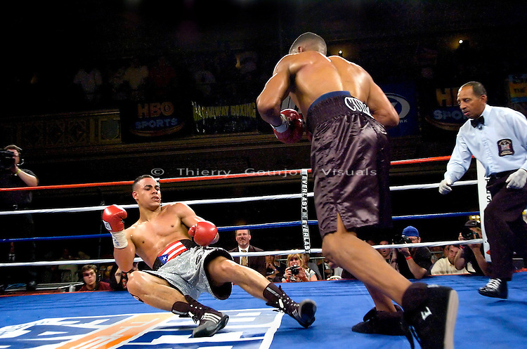Manhattan Center, N.Y: (l-r) Edgar Santana falls to the canvas after being knocked out by  Harrison Cuello during their 10 rounds Junior Welterweight fight, Wednesday, June 20, 2007.  Cuello won the upset victory over heavily favorite Santana by KO in the 3rd round..