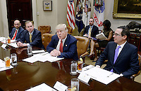 United States President Donald Trump discusses the Federal budget in the Roosevelt Room of the White House on February 22, 2017 in Washington, DC. OMB director Mick Mulvaney sits to the President's right and Treasury Secretary Steven Mnuchin sits to his left. Photo Credit: Olivier Douliery/CNP/AdMedia