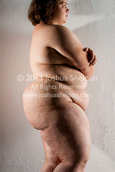 Overweight nude woman, side view