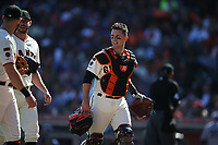 SAN FRANCISCO, CA - SEPTEMBER 28:  Buster Posey #28 of the San Francisco Giants walks off the field during the game against the Los Angeles Dodgers at Oracle Park on Saturday, September 28, 2019 in San Francisco, California. (Photo by Brad Mangin)