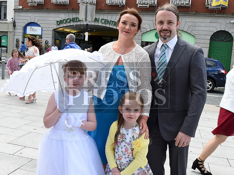 Aoibheann Mullen who received first holy communion in St Peters church West street pictured with her parents Tom and Anne and sister Caitlin. Photo:Colin Bell/pressphotos.ie