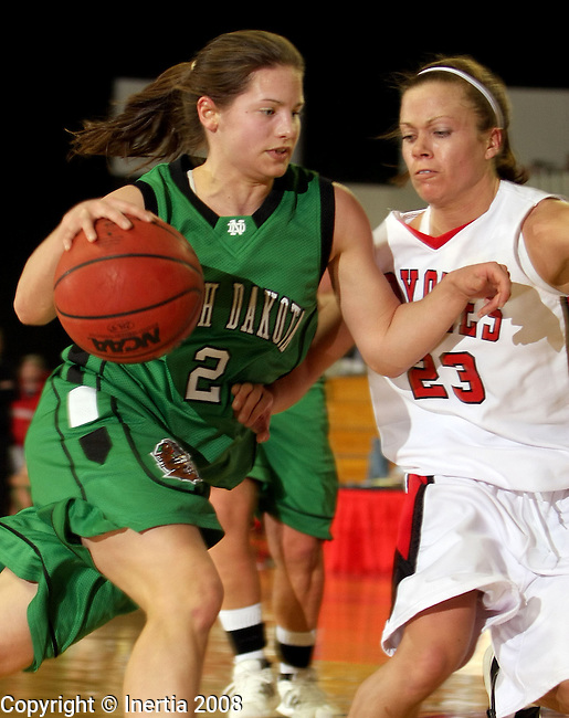 VERMILLION, SD - FEBRUARY 21: Alys Seay #2 of the University of North Dakota  runs into the defense of Jeanna Hoffman #23 of the University of South Dakota in the first half of their NCAA basketball game Thursday night at the DakotaDome in Vermillion. (Photo by Dave Eggen/Inertia)