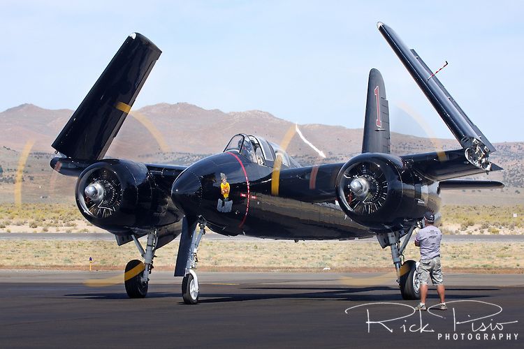 A Grumman F7F Tigercat does an engine run up on the ramp during the Reno National Championship Air Races. There were 364 of the twin engined fighters built during World War II, and shortly thereafter, of which there are six that are still considered airworthy. Originally Grumman had been contracted to build 500 of the aircraft for use by the US Marine Corps to be used as close air support of the landing operations that were planned in the Pacific.