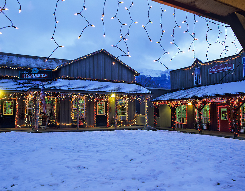 Shopping area with snow and Christmas lights. Joseph, Oregon