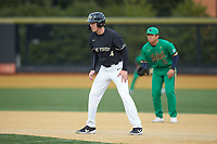 DJ Poteet (4) of the Wake Forest Demon Deacons takes his lead off of first base against the Notre Dame Fighting Irish at David F. Couch Ballpark on March 10, 2019 in  Winston-Salem, North Carolina. The Fighting Irish defeated the Demon Deacons 8-7 in 10 innings in game two of a double-header. (Brian Westerholt/Four Seam Images)