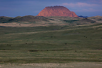 Evening light hits hills at the eastern edge of the Rocky Mountain Front outside Fort Shaw, Montana, USA.