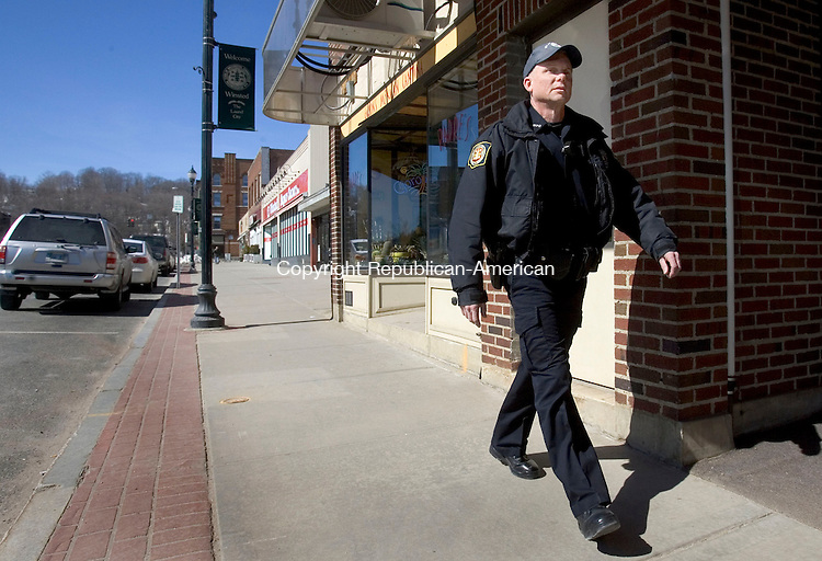 WINSTED CT. 06 March 2014-030614SV01-Officer Christopher Skinner heads out on foot patrol during his shift downtown Winsted Thursday.<br /> Steven Valenti Republican-American